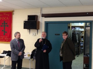 Fr. Gregory accepting award for St. Mark's outreach to Stepping Stones Shelter
